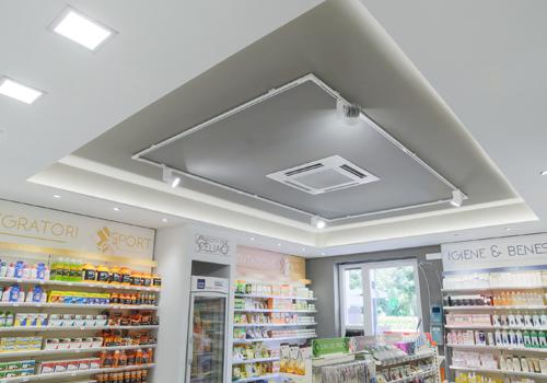 Faux plafond am nagement pharmacie agencement de for Faux plafond magasin